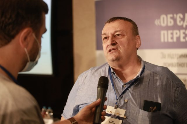 Ihor Dyadyura, Deputy Minister of Economy, is being interviewed about the problems raised by small business/
